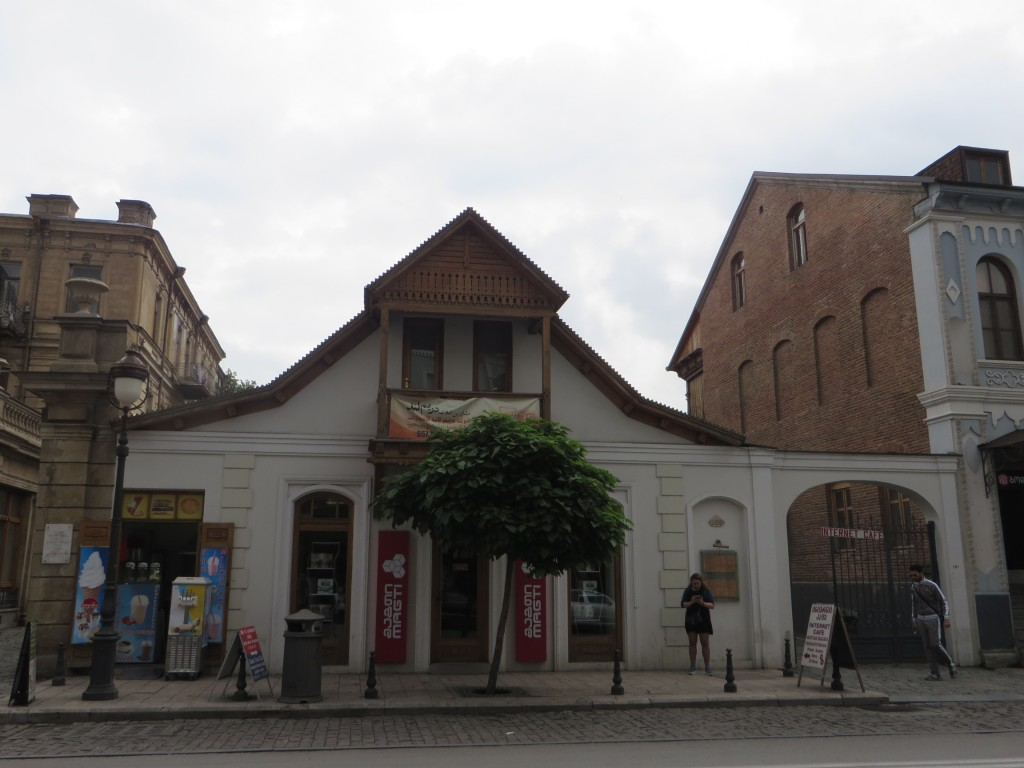 109a Aghmashenebeli Street. On the Right Side of the Façade there is a Stand with Information on Neutiflis Settlement